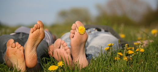 barefeet lying in grass